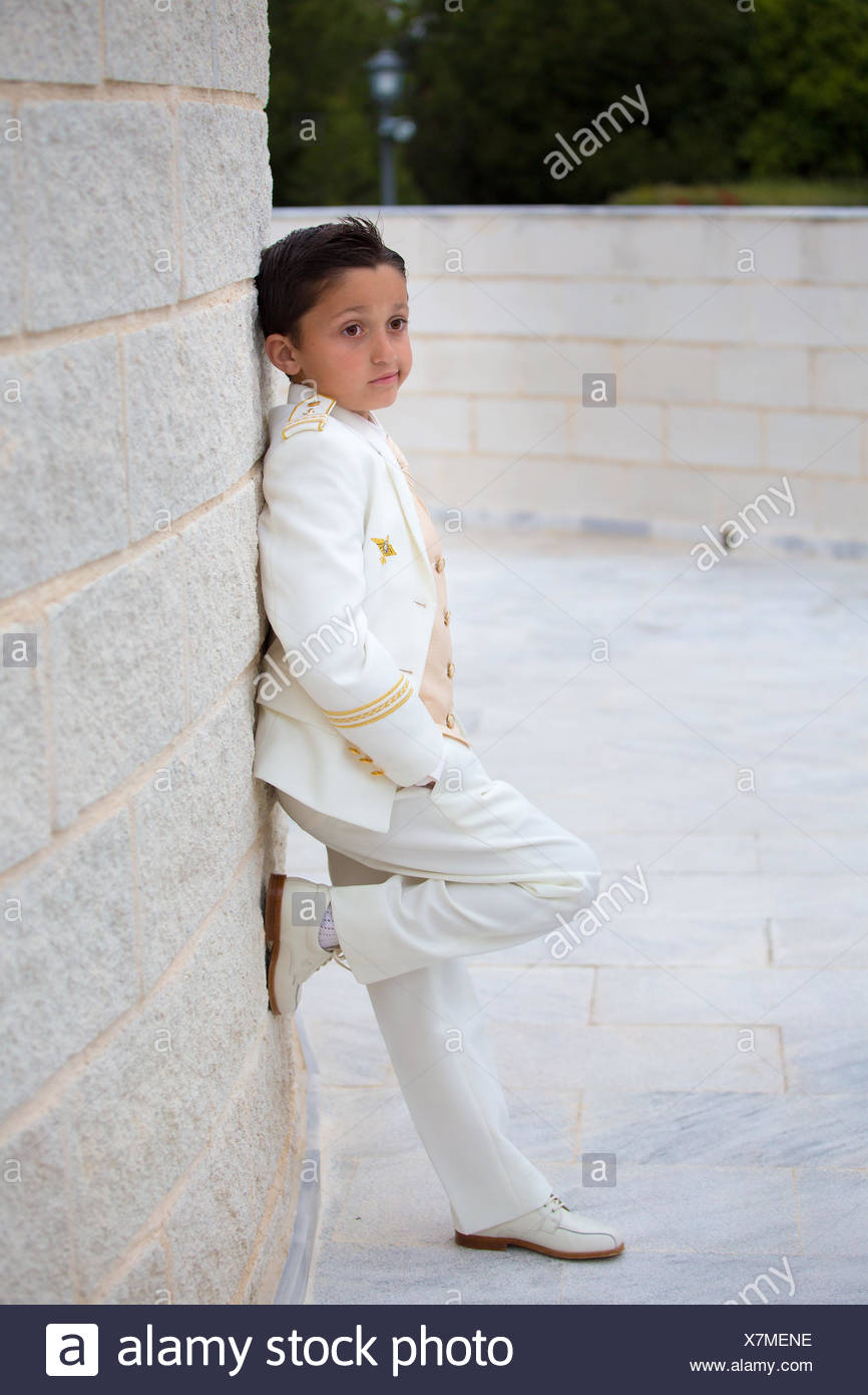 Young First Communion Boy Leaning On A Wall With One Foot Stock Photo Alamy