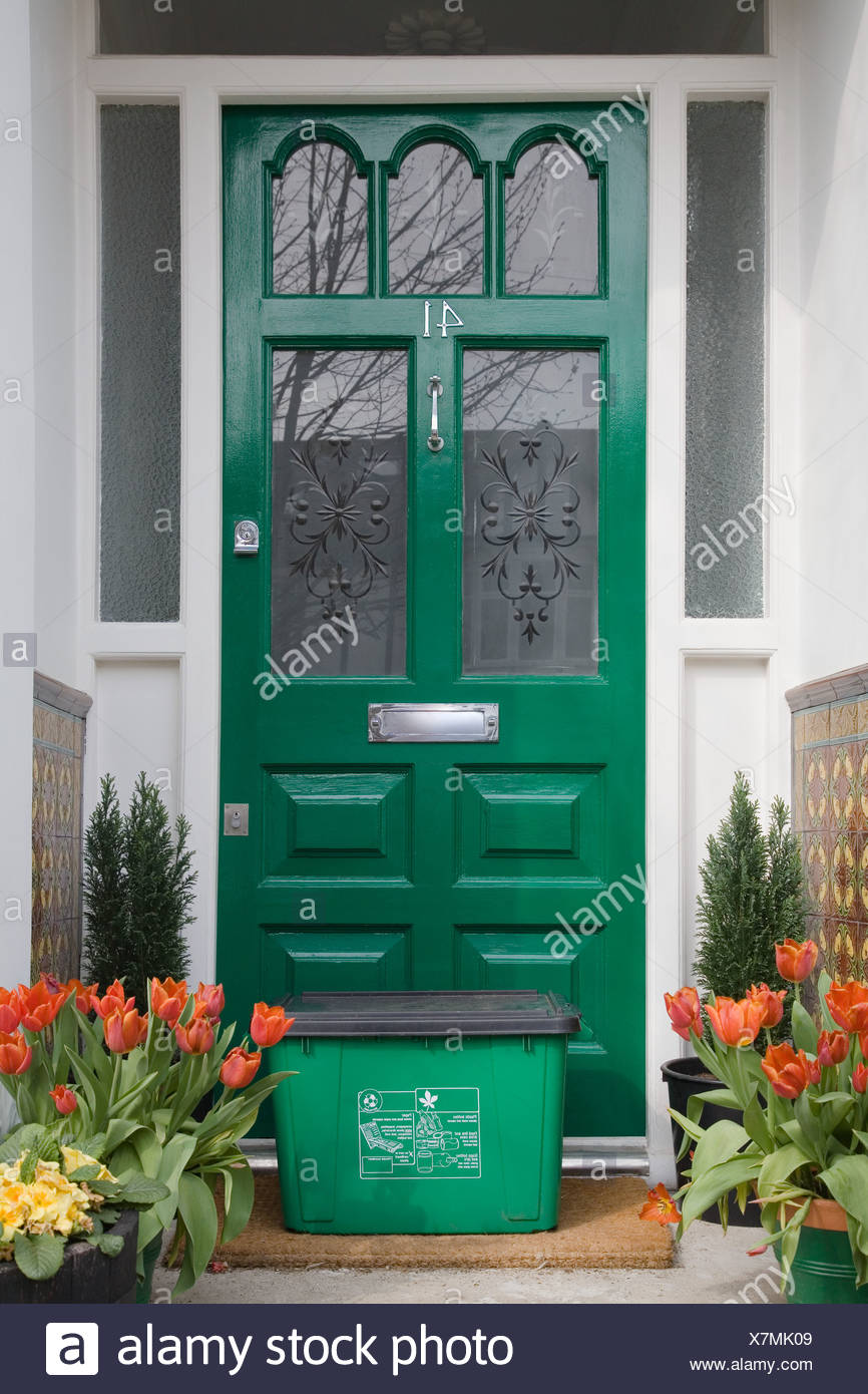 Recycling box by front door - Stock Image