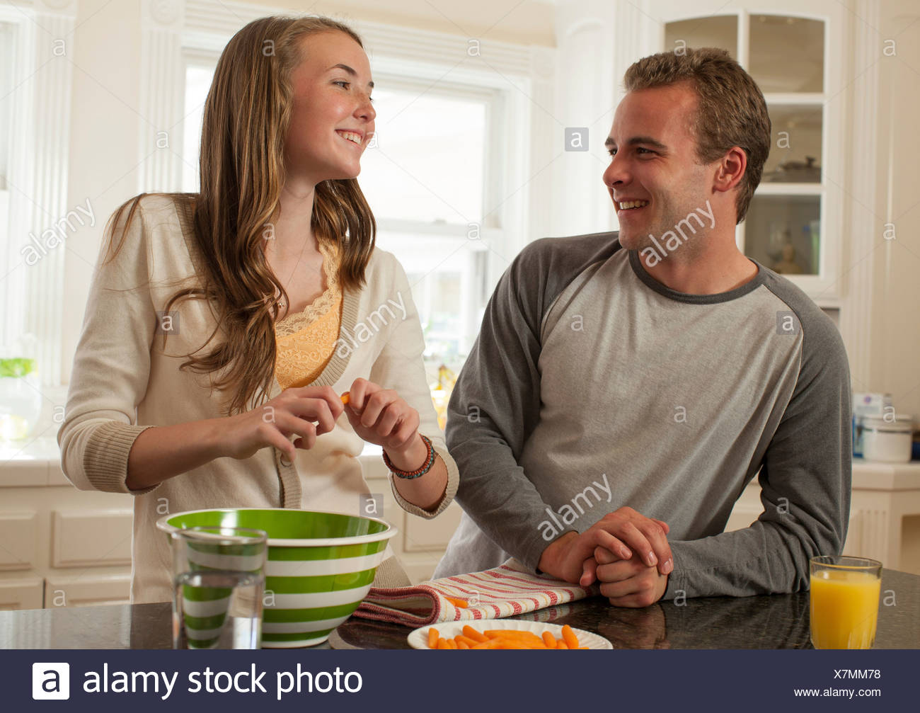 Brother and sister preparing food - Stock Image