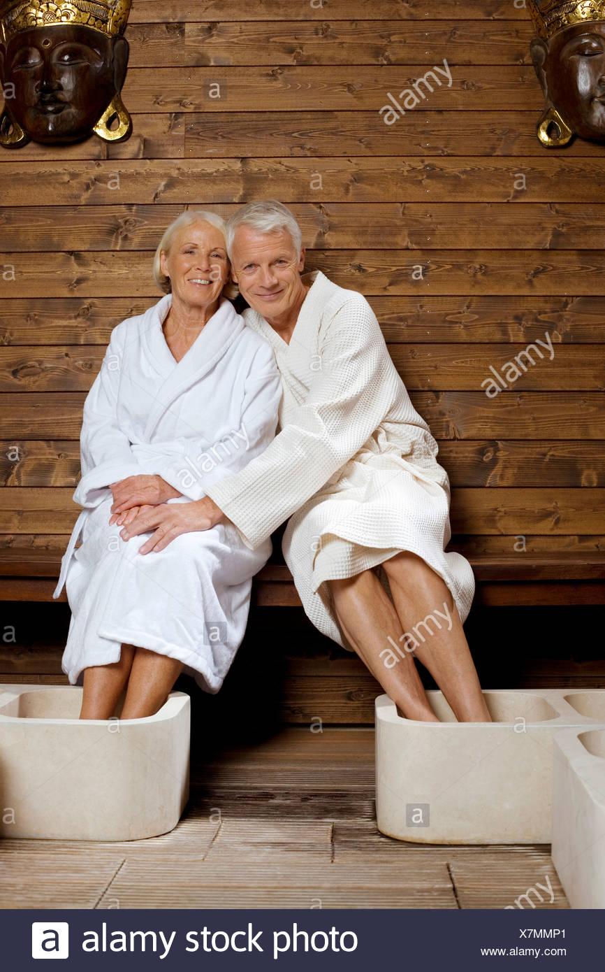 Germany, Senior couple wearing bath robes - Stock Image