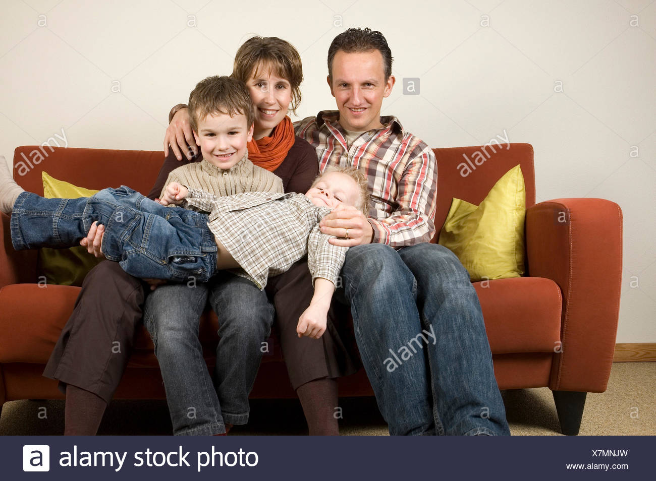 Family On A Couch 5 - Stock Image