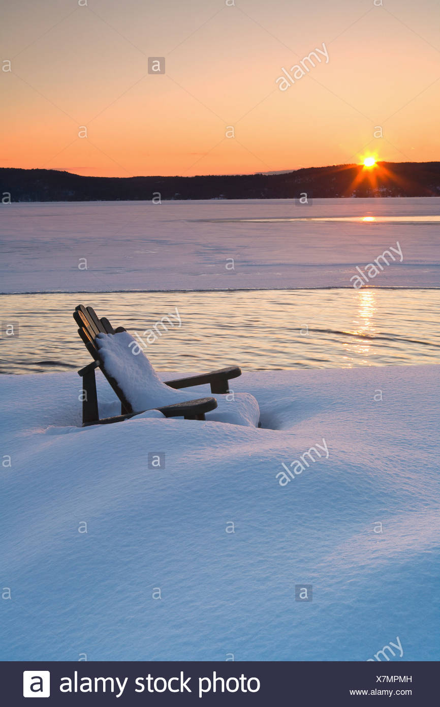 Deck chair on snow-covered sea - Stock Image