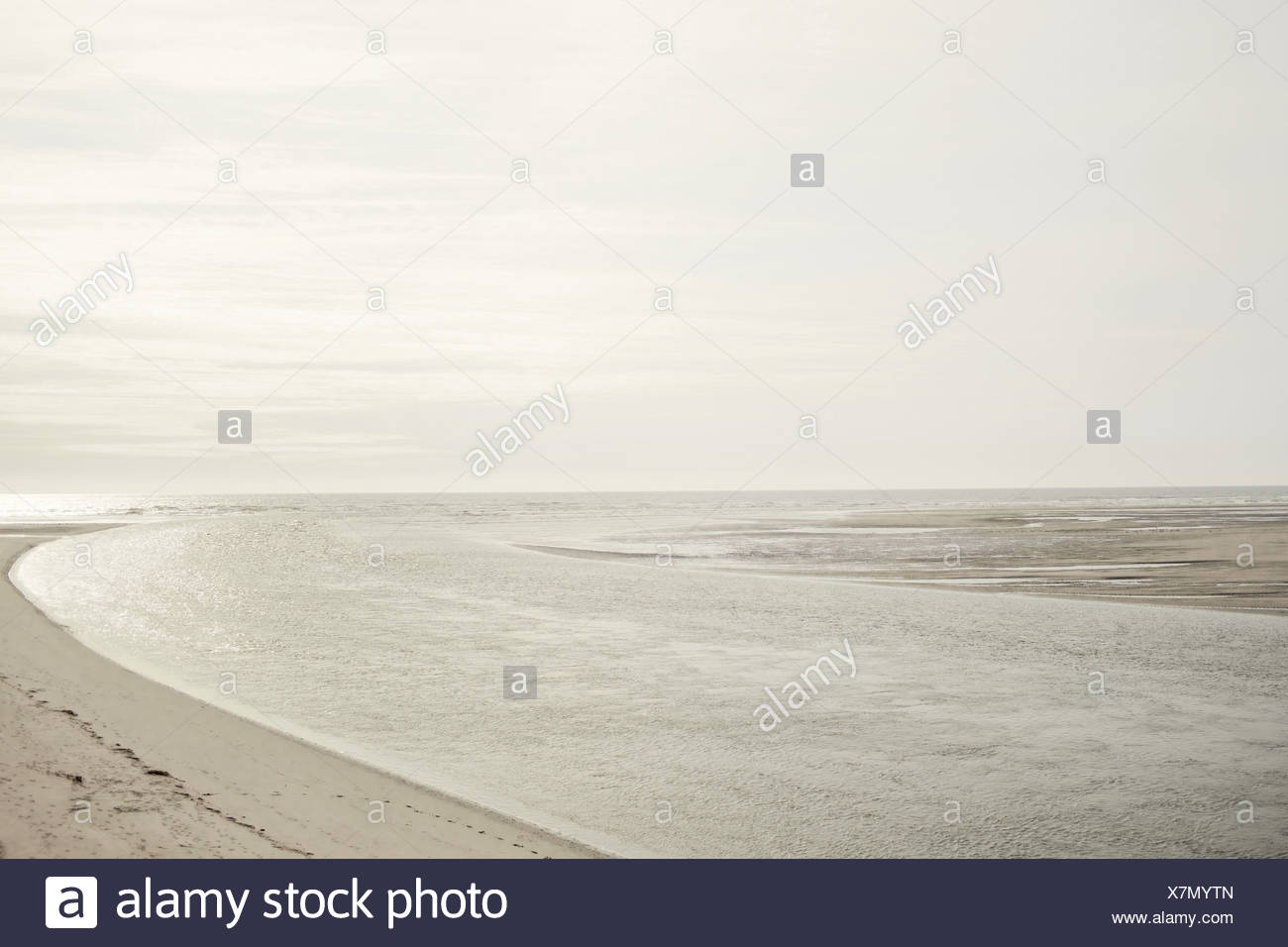 Beach scene with calm water Stock Photo