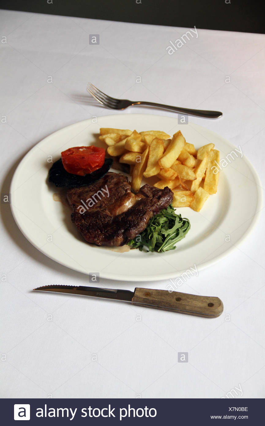 Sirloin Steak And Chips With Vegetables - Stock Image
