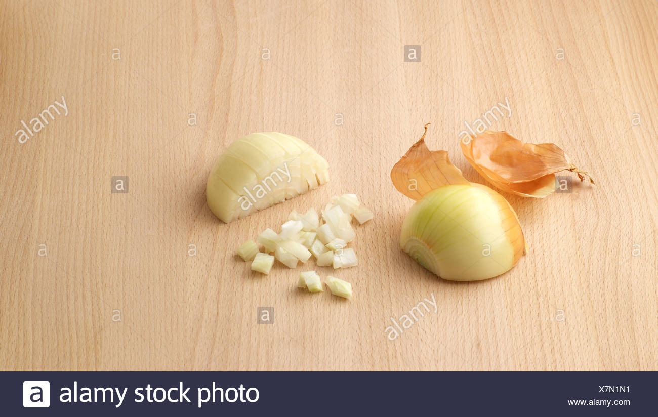 Onion peeled and chopped - Stock Image