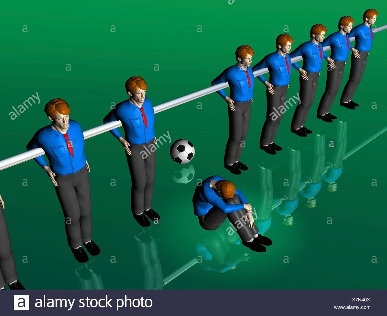 Table soccer figures, one sitting on the ground, illustration, symbolic image - Stock Image