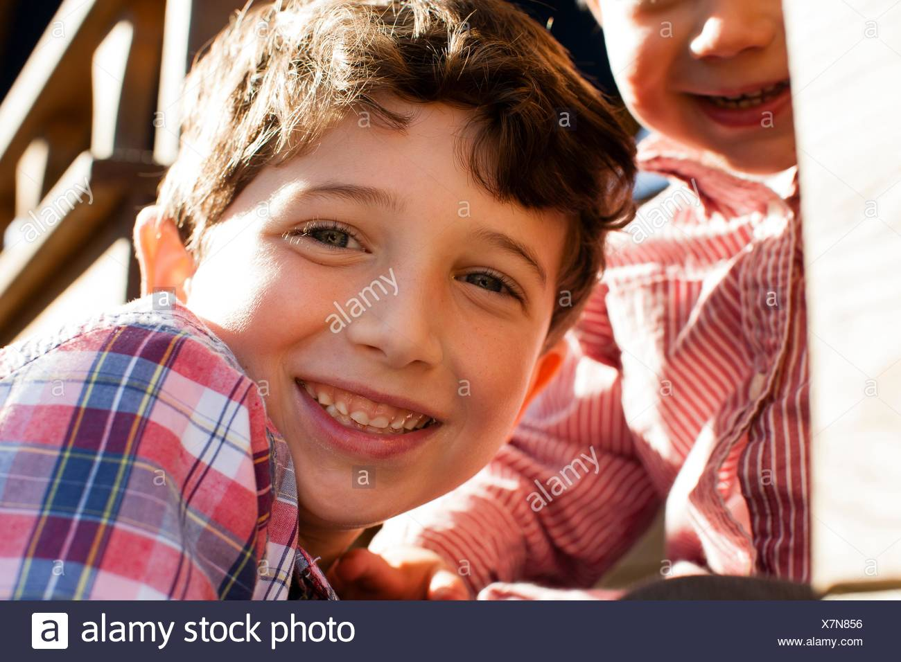 Close up of boy with big brother looking at camera smiling Stock Photo