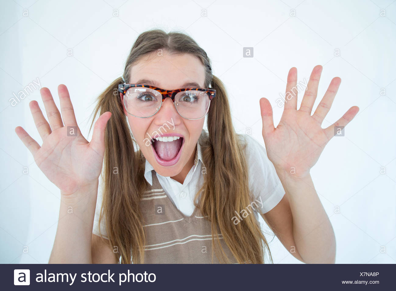 Female geeky hipster smiling at camera - Stock Image