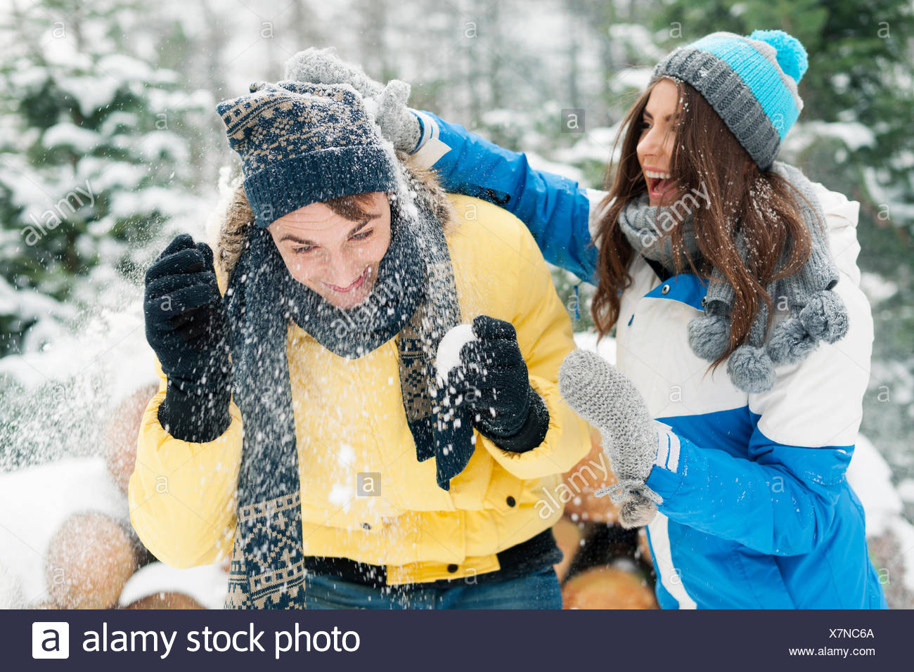 Young couple have fun during the snowball fight. Debica, Poland - Stock Image