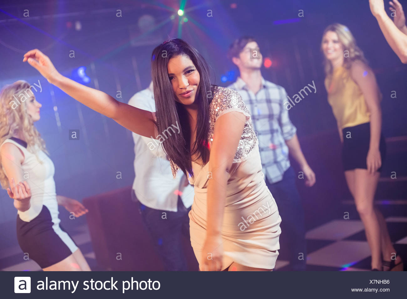 Happy friends dancing cheerfully - Stock Image