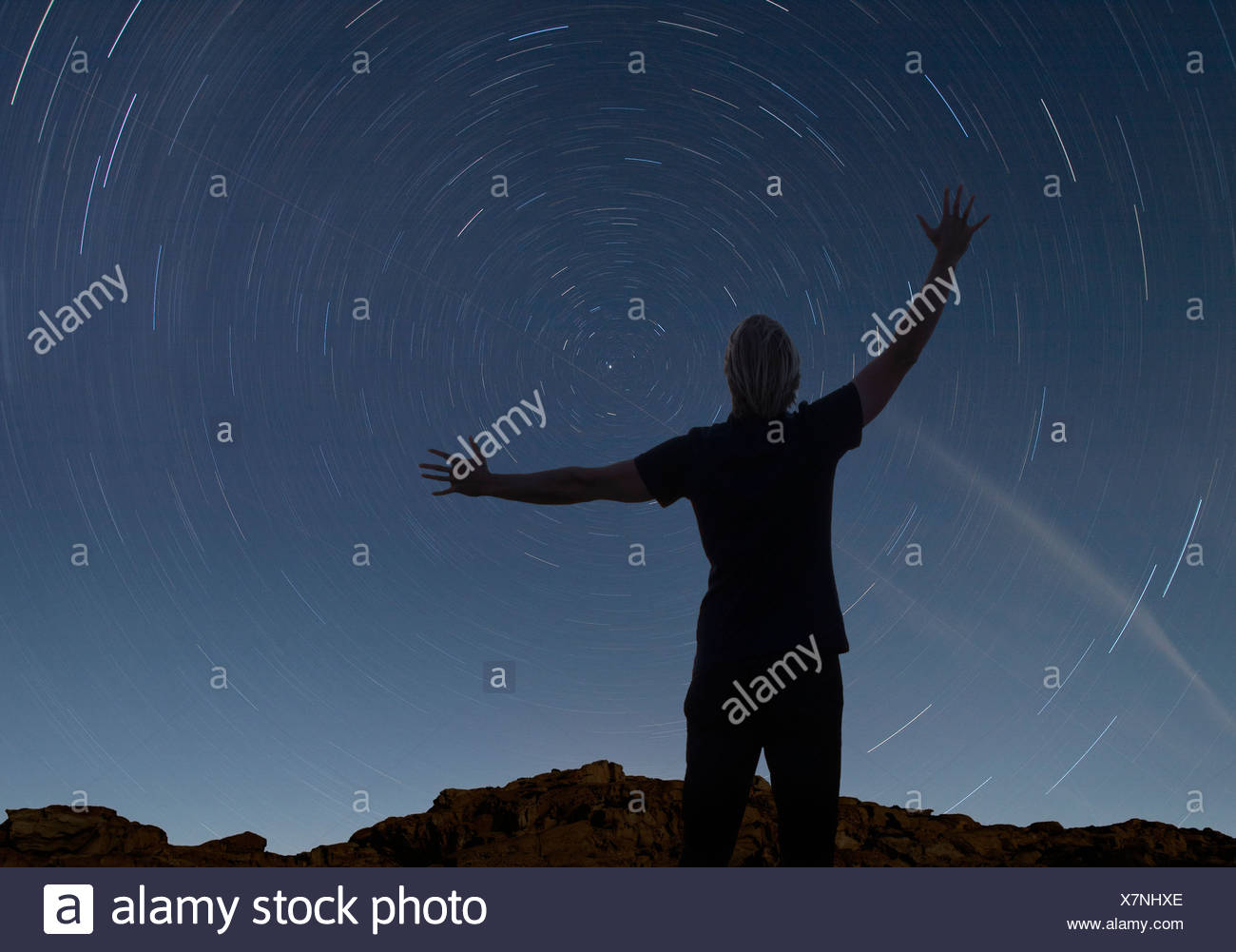 man watching the starry night sky - Stock Image