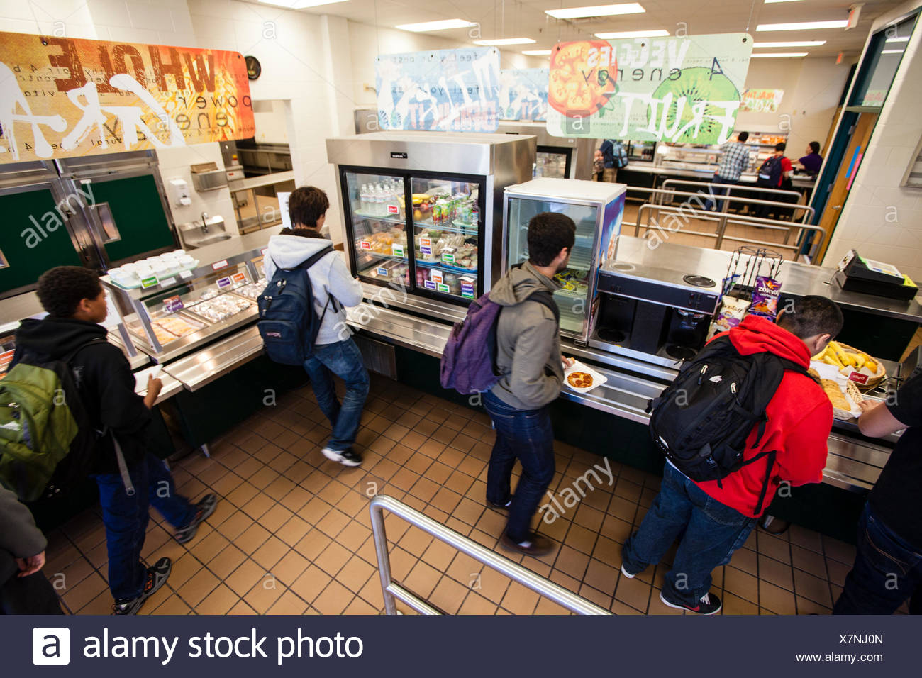 Teenagers in a cafeteria line in high school. - Stock Image