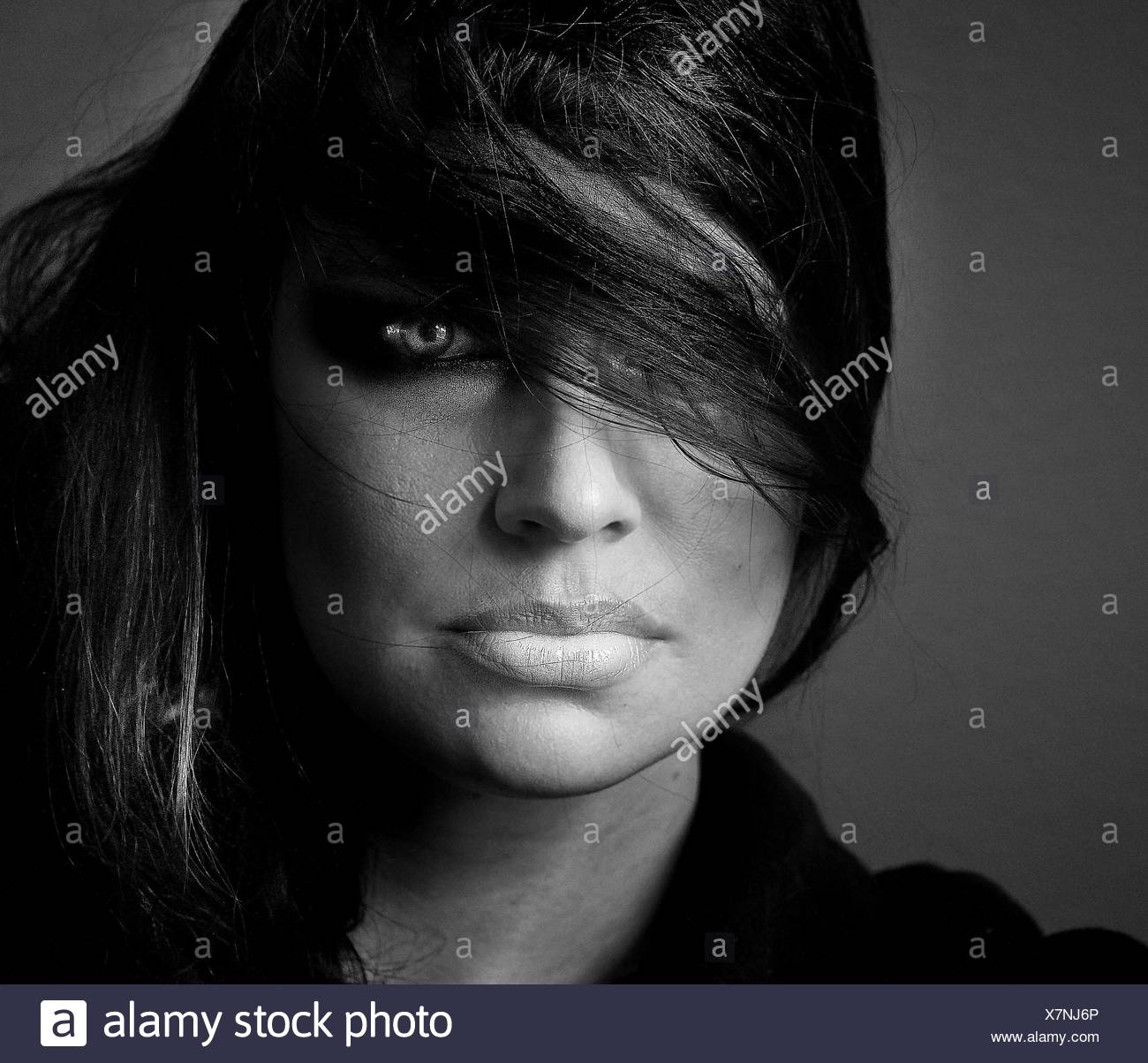Close-Up Portrait Of Woman With Tousled Hair - Stock Image