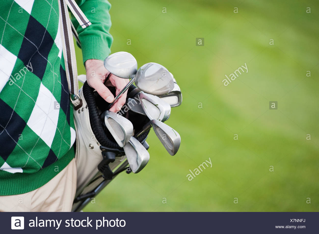 Italy, Kastelruth, Mature man with carrying golf bag, close up Stock Photo