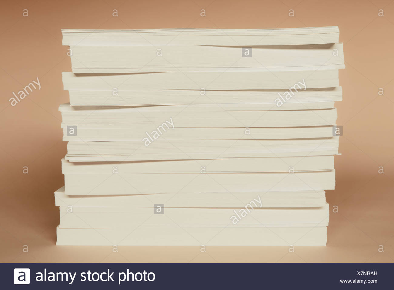 A stack of recycled white paper, paper supplies. - Stock Image