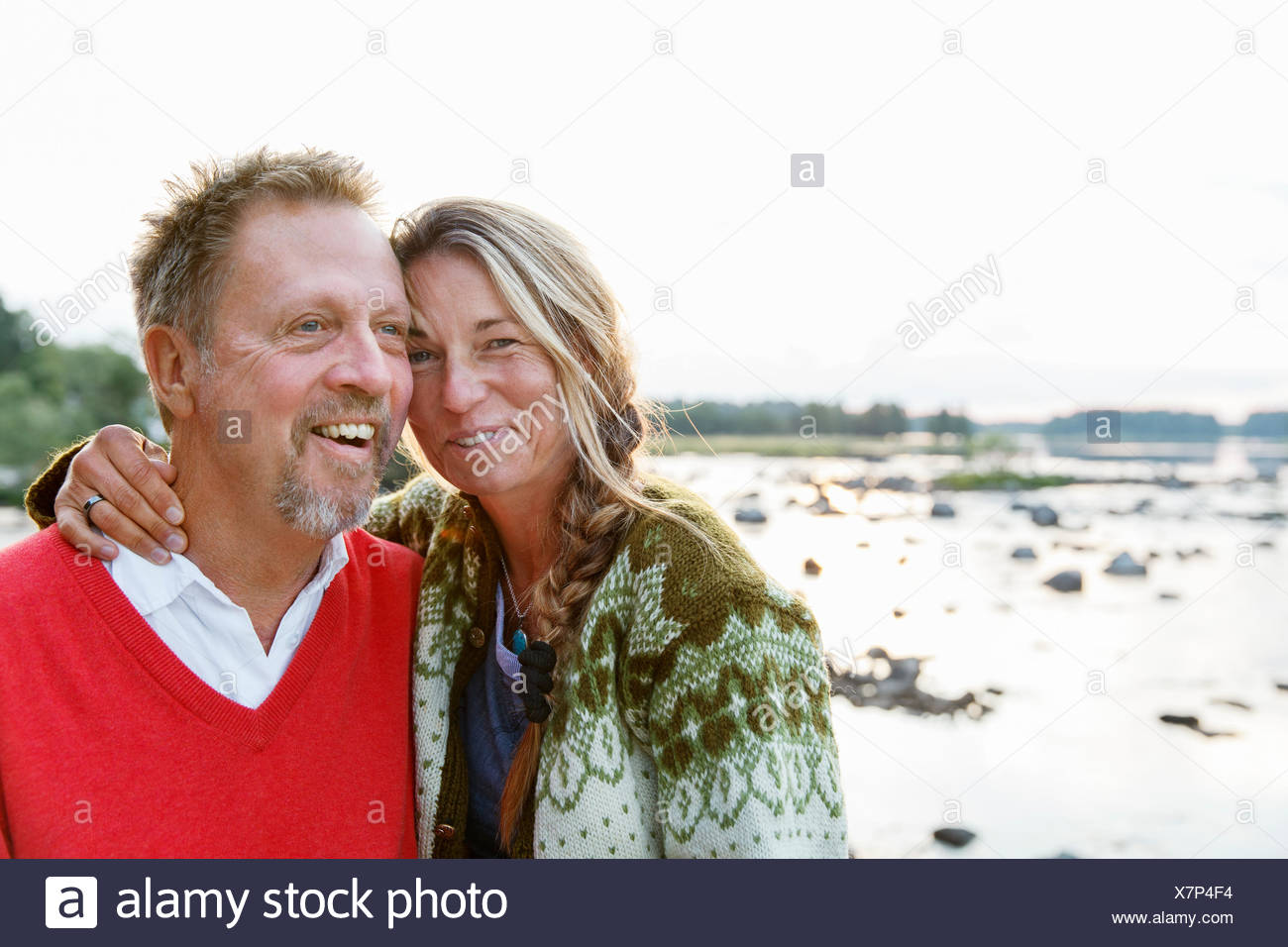 Sweden, Gastrikland, Dalalven, Man and woman by lake - Stock Image