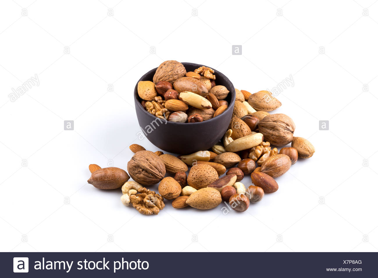 Nuts mix in bowl - Stock Image