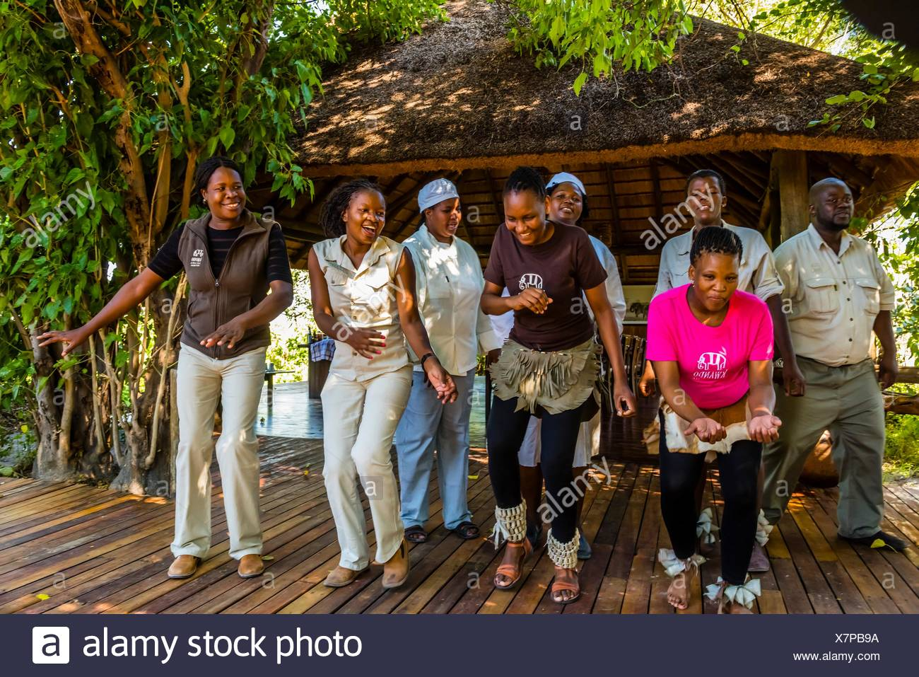 Staff members of the Lebala Safari Camp at the Kwando Concession do a traditional singing and dancing performance, Botswana. Stock Photo