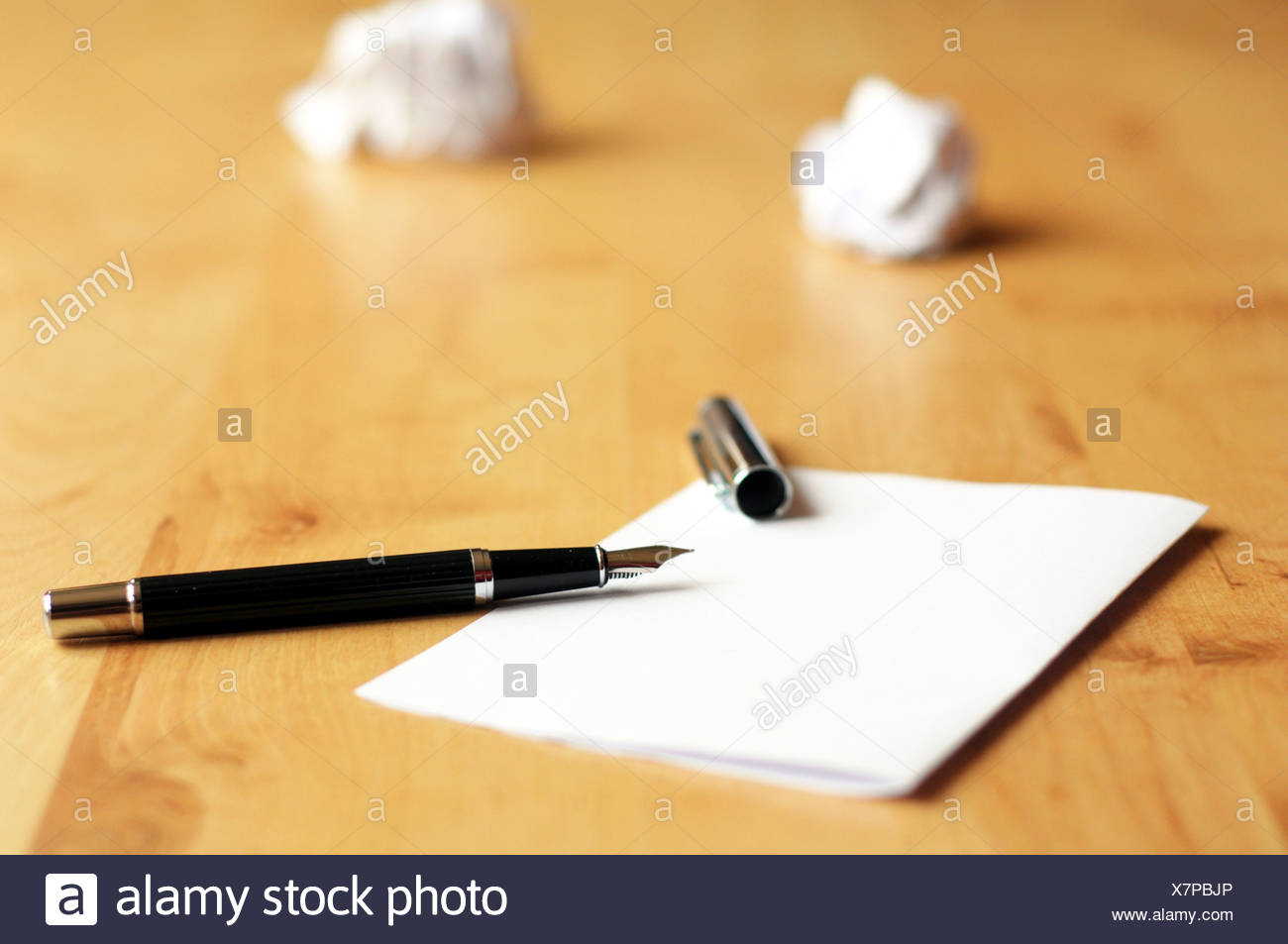 pen and paper in a wooden desktop showing creativity concept Stock Photo