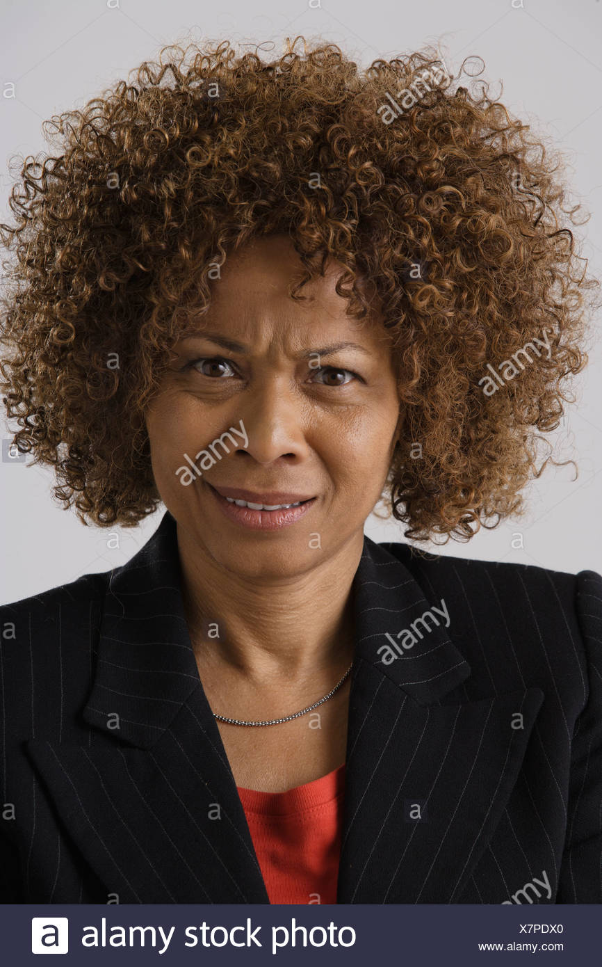 Portrait of mature businesswoman, studio shot - Stock Image