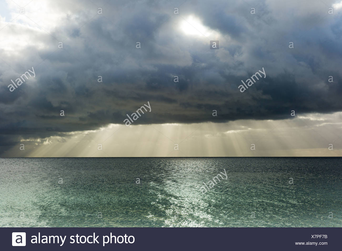 Prora, Germany, sunbeams shining through a thick cloud cover over the Baltic Sea - Stock Image