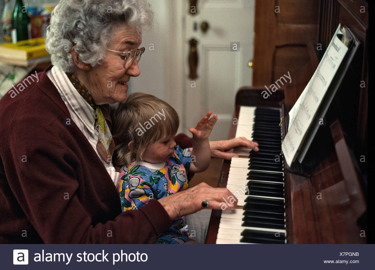 grand mother and 9 month old granddaughter at the piano