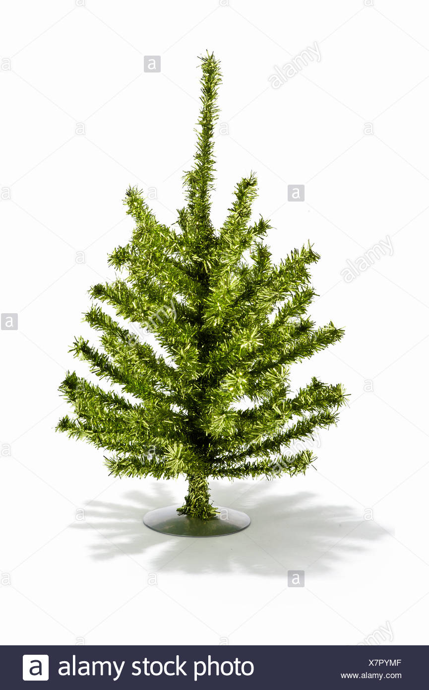 A small artificial Christmas tree - Stock Image