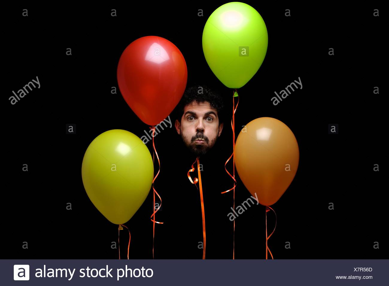 Man's head on ribbon with multicolored balloons - Stock Image