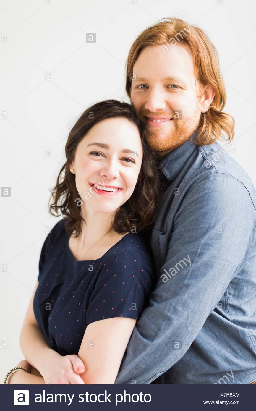 Portrait of smiling couple - Stock Image
