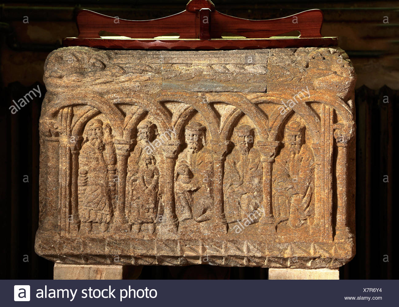 Sculthorpe church, Norman 12th century Font, Adoration of the Magi, stone carvings in interlocking Romanesque arches, Norfolk England UK - Stock Image
