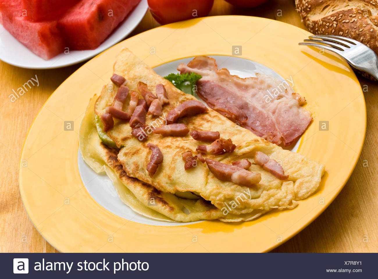 omelet with thin bacon bacon,croissant - Stock Image