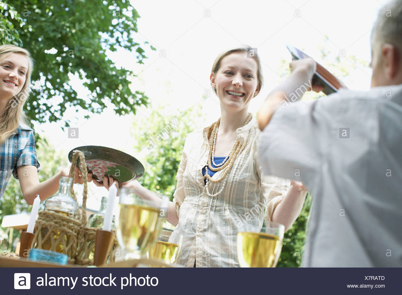 Family enjoying picnic in backyard - Stock Image