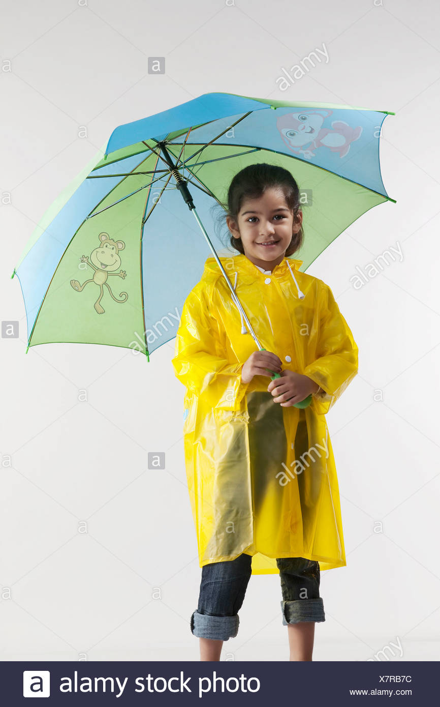 There young girls raincoats