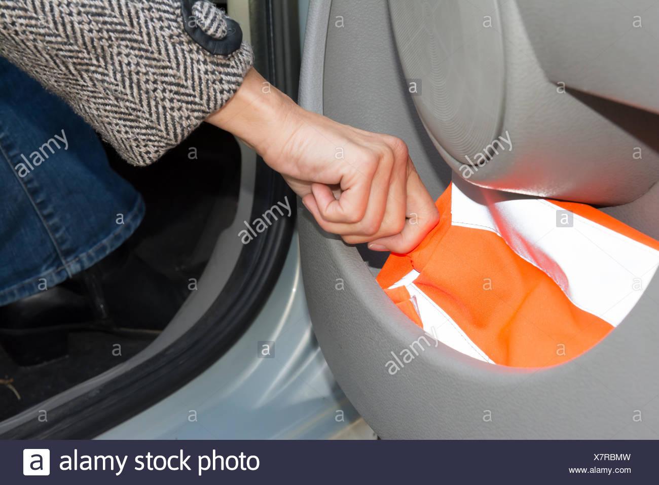 reflective vest in car door - Stock Image
