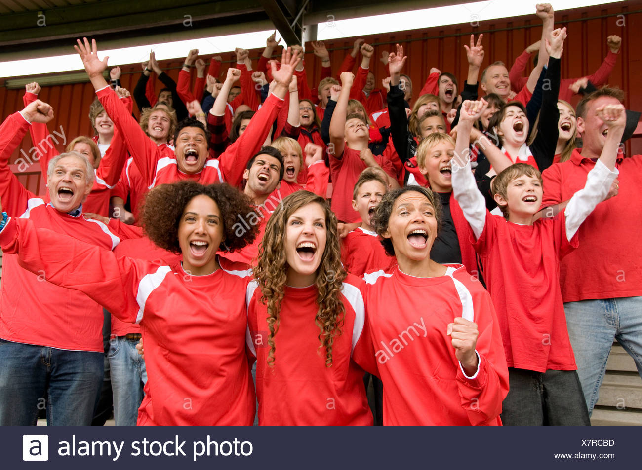 Group of football supporters celebrating - Stock Image