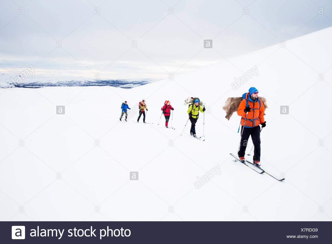 People skiing in mountains - Stock Image