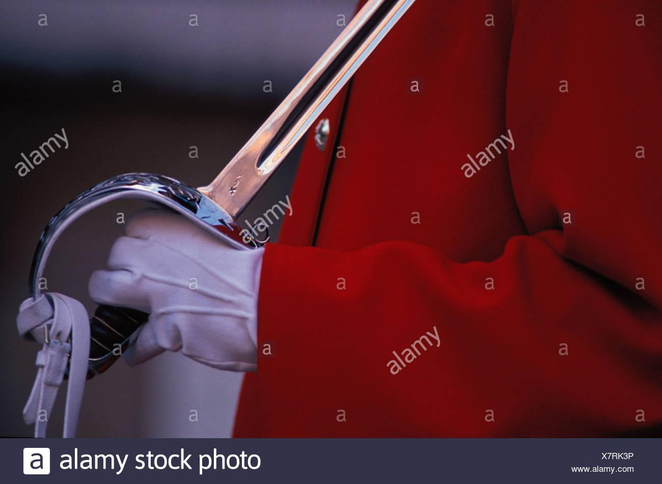Soldier in Dress Uniform Holding Sword - Stock Image