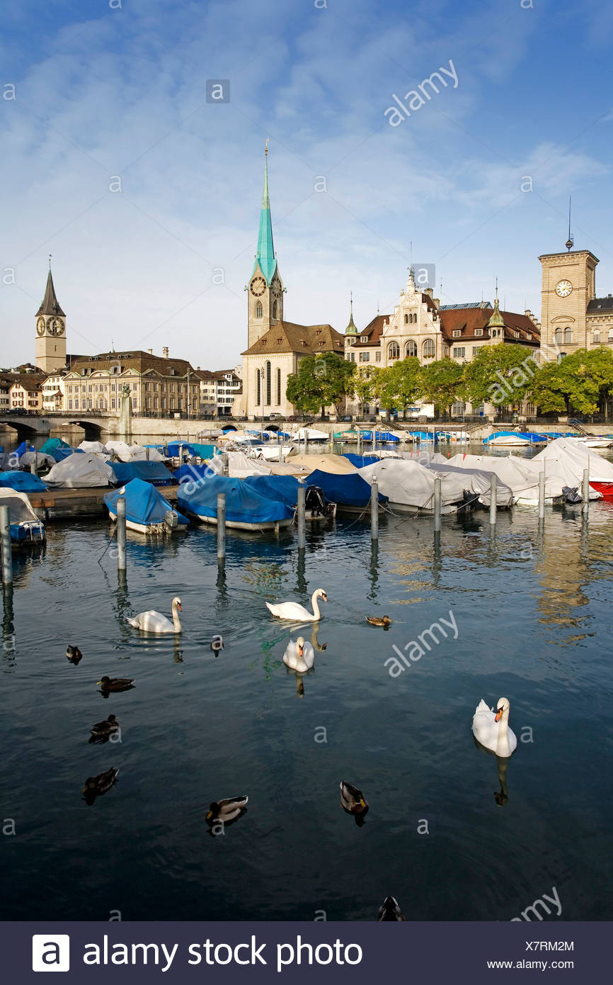 Historic centre of Zurich on Limmat River, Fraumuenster Church on the left, St. Peterskirche Church on the right, Zurich, Switz - Stock Image