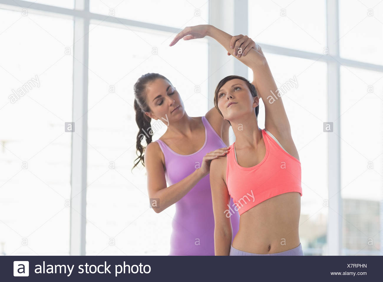 Instructor guiding woman - Stock Image