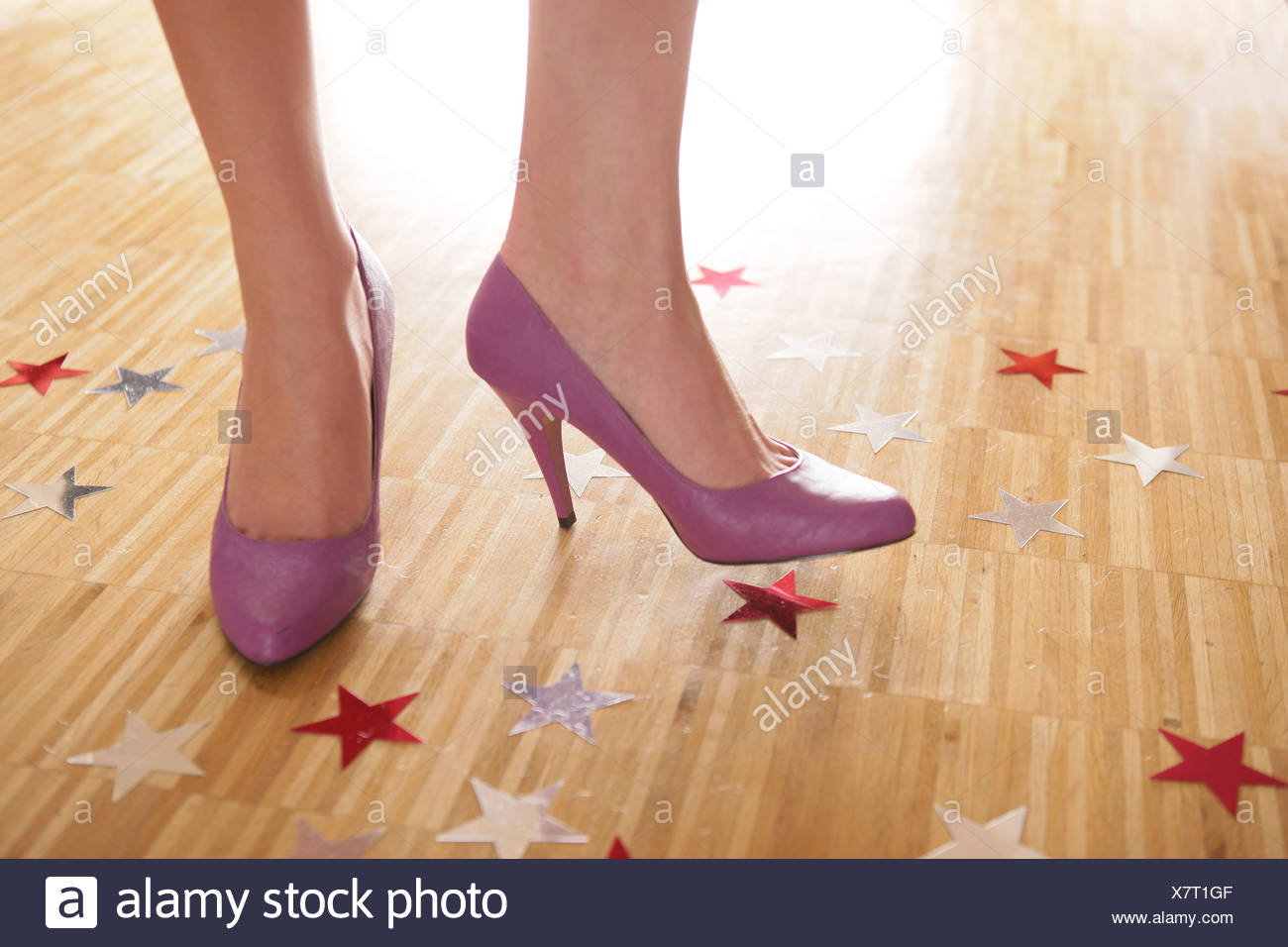 Feet and shoes of a female dancer on a wooden floor Stock Photo