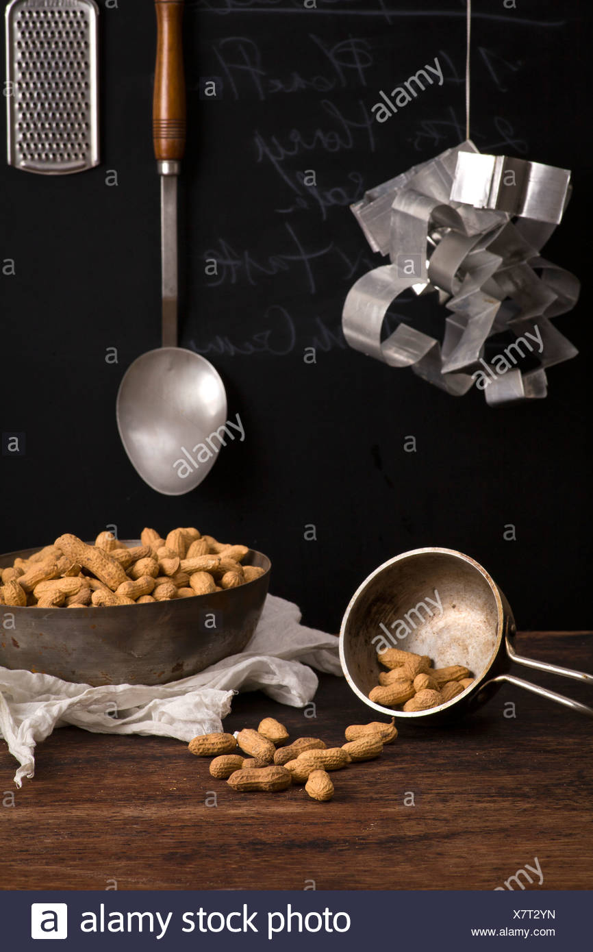 Dried peanuts on table. Recipe with milk and peanuts - Stock Image