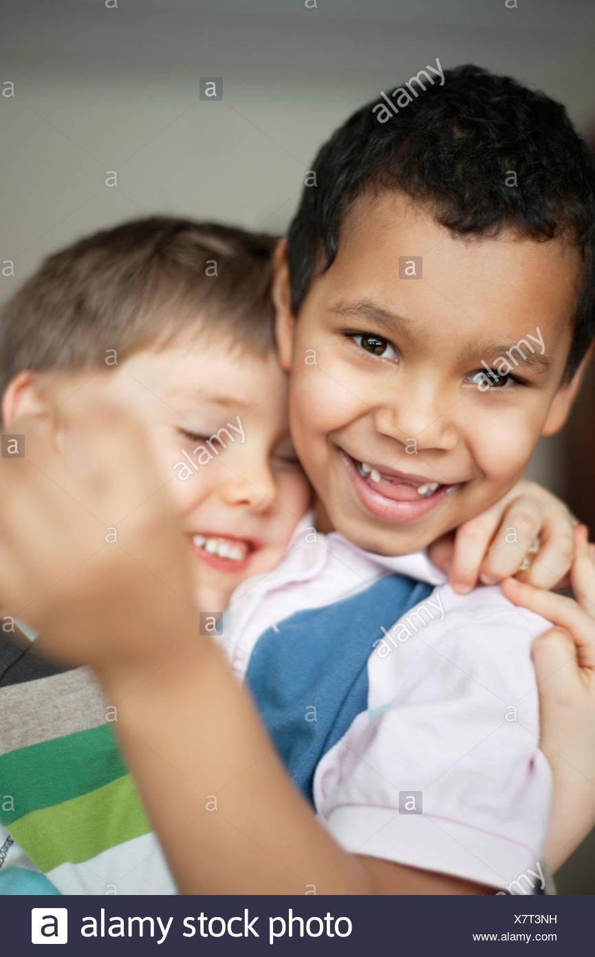 Playful elementary aged boys - Stock Image