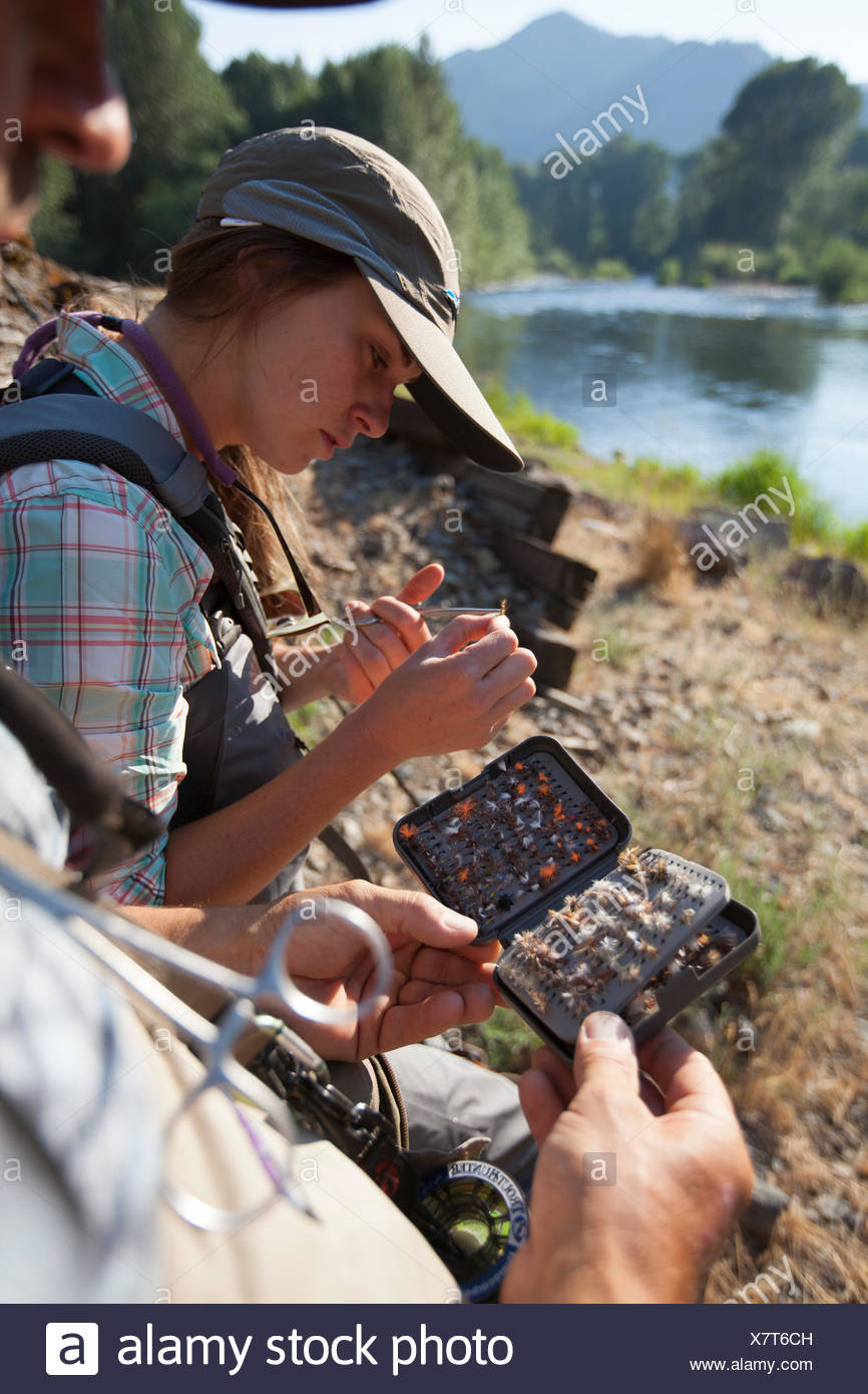 Two People Preparing Bait For Fly Fishing On The Big Wood River Near Ketchum Idaho Stock Photo