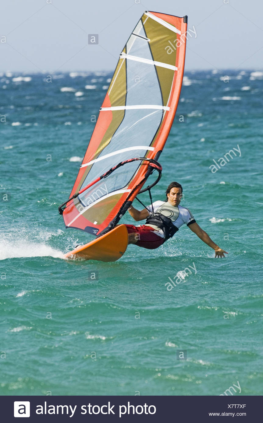 windsurfing in tarifa with strong levante wind - Stock Image