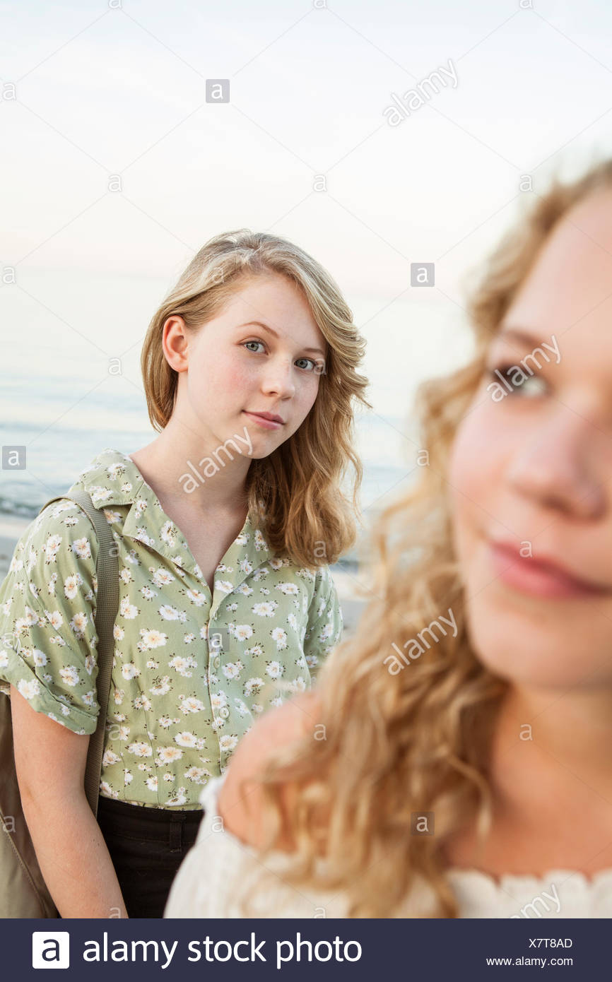 Sweden, Blekinge, Hallevik, Front view of two teenage girls (14-15, 16-17) at bay - Stock Image