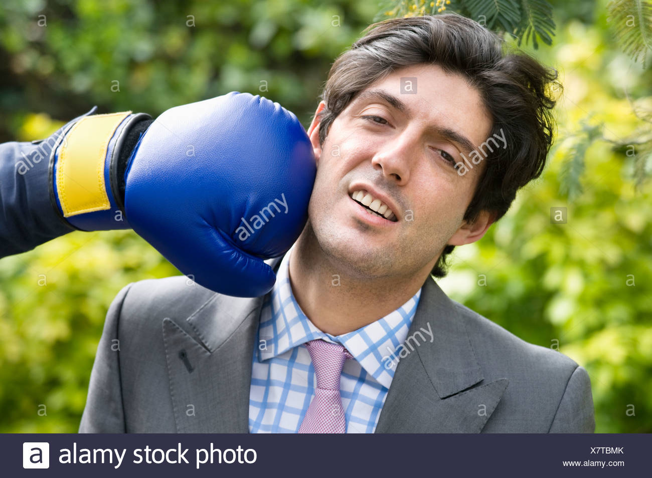 Young man getting hit - Stock Image