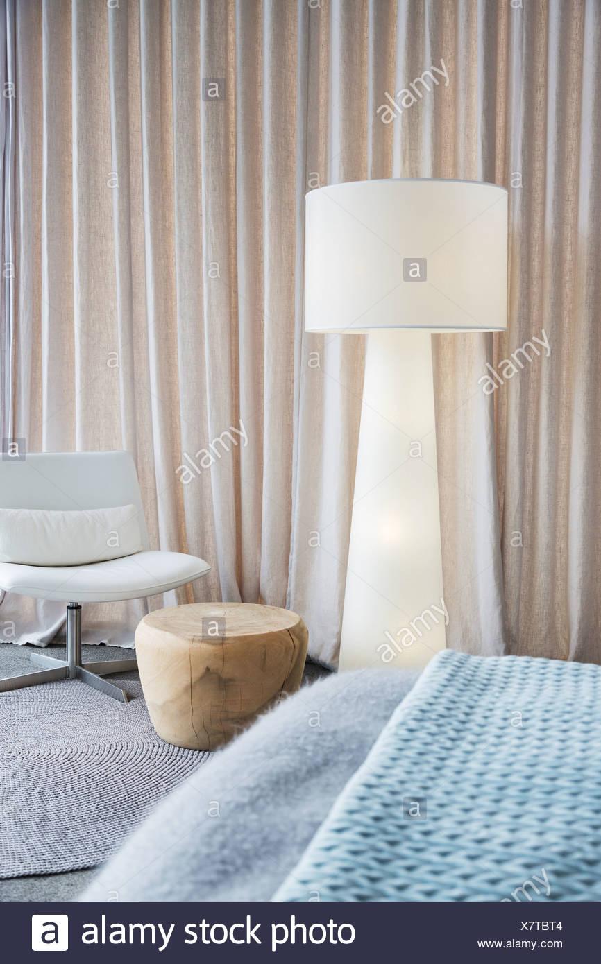 Lamp in modern bedroom - Stock Image