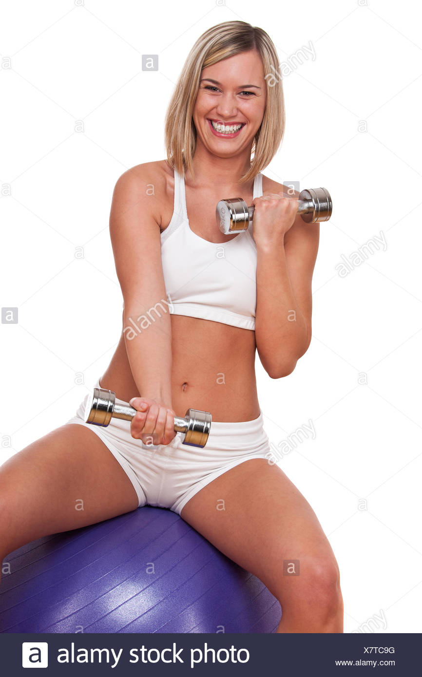 Fitness series - Smiling blond woman exercising with weights - Stock Image