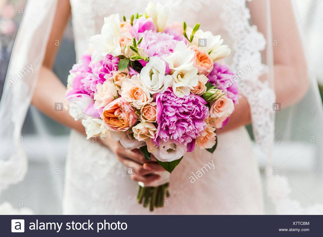 Midsection Of Bride Holding Bouquet - Stock Image