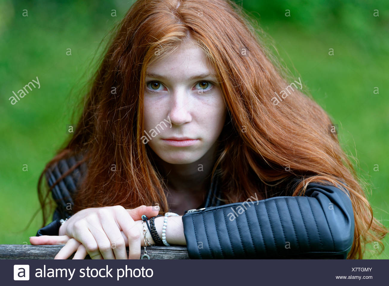 Female teenager, thoughtful disposition, portrait, Upper Bavaria, Bavaria, Germany - Stock Image